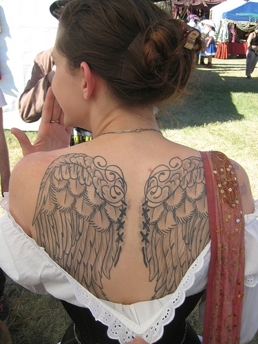 Angel with halo tattoo on