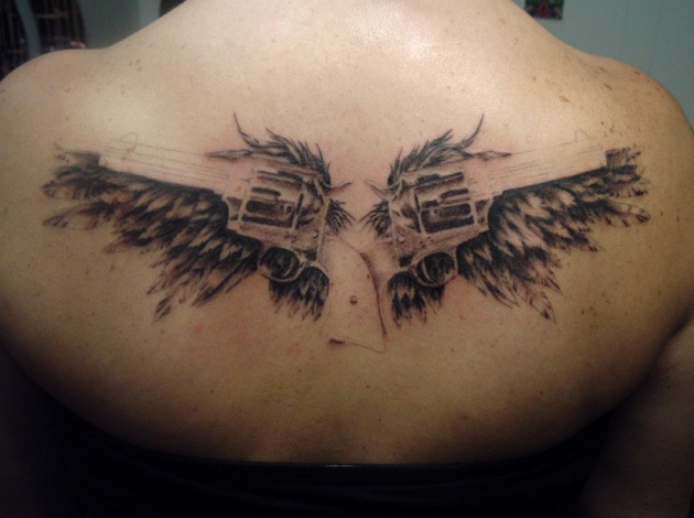 angel wings with guns tattoos