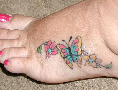 Cute little foot shamrock tattoo. Kind of small