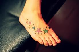 small star tattoos on foot
