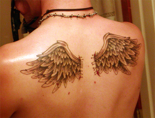 Angel Wing Tattoos. Some angel wing tattoos are small designs.
